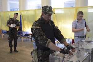 A Ukrainian soldier casts his ballot in a presidential election at a polling station in the village of Dobropillya